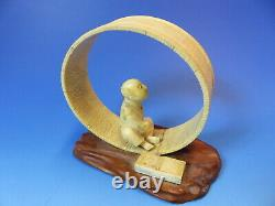 Antique Japanese okimono of a man seated within a handmade tub